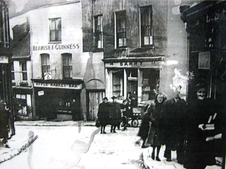 An image looking down Barrack Street in the 1930s with views of the Apple Market Bar and Barrys Pub